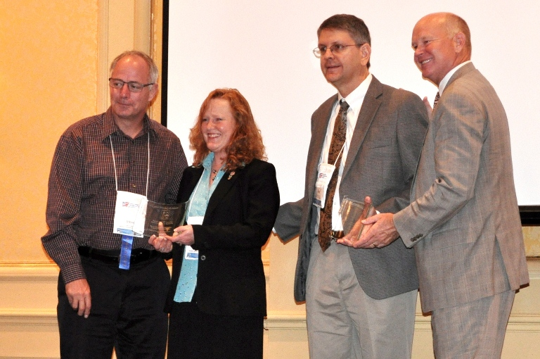 Left to right: Steve Albert, Leann Koon, Sean Campbell, Scott Belcher. 2012 Best of Rural ITS Award presentation.